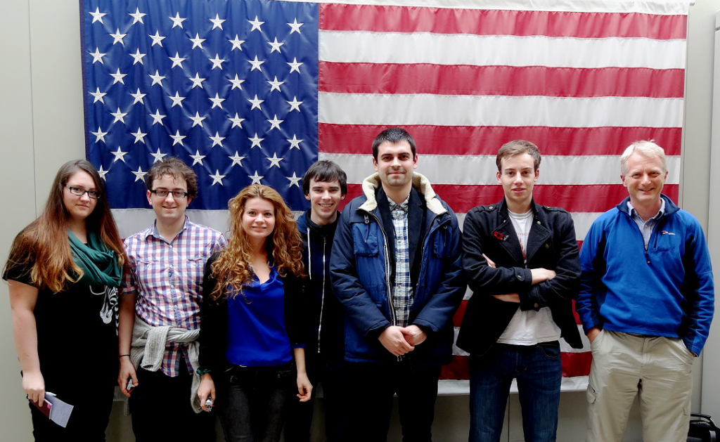 The iGEM team in Boston, in front of an American flag.