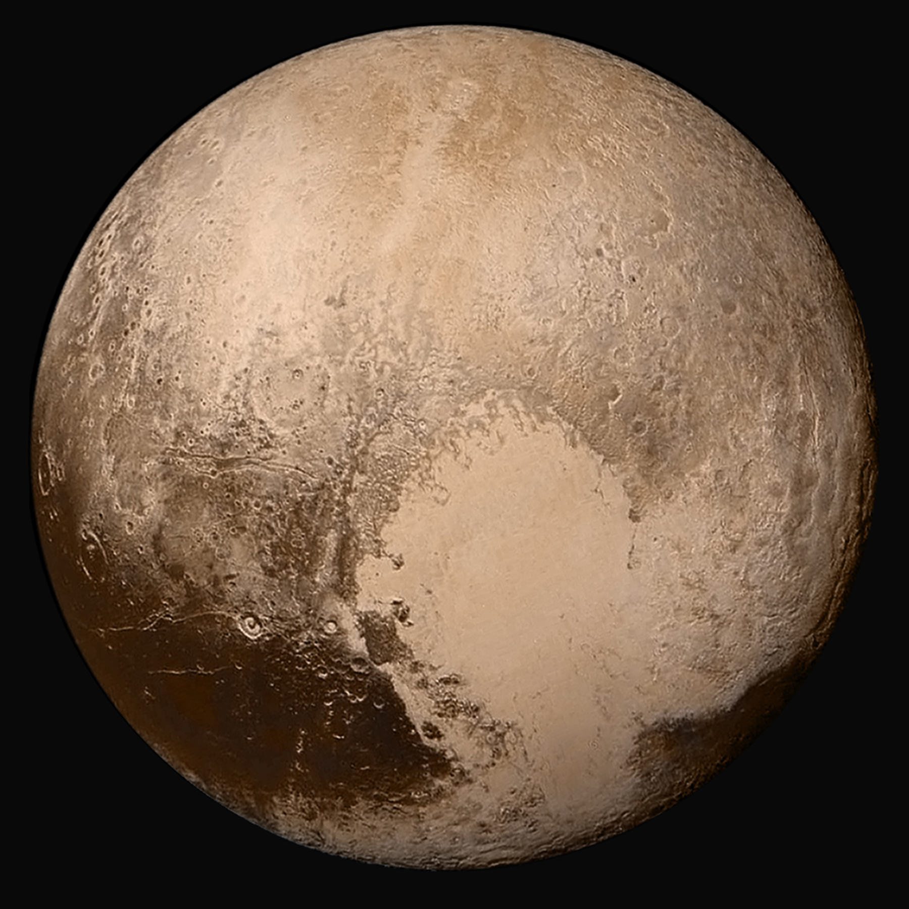 Picture 2: Pluto and its famous heart-shaped surface feature.